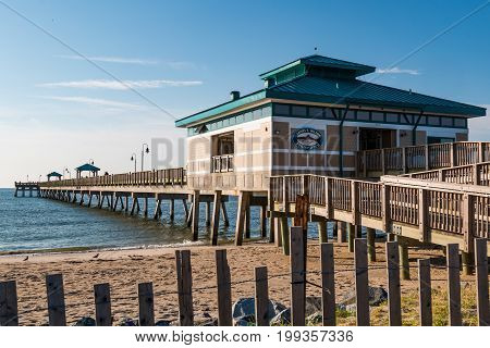 HAMPTON, VIRGINIA - JULY 9, 2017:  The James T. Wilson fishing pier, located at Buckroe Beach on the site of a former plantation.  The area is now popular for the beach, fishing and a public park.
