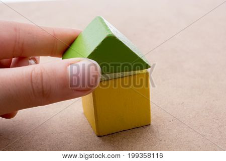 Hand Holding A House  Formed Out Of Building Blocks