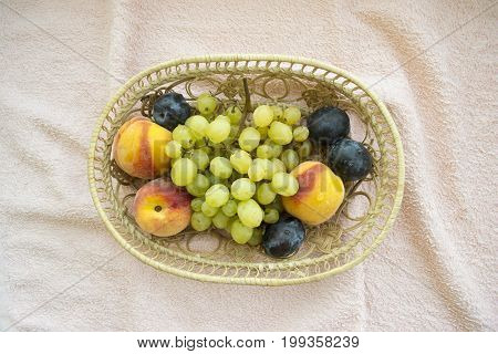 Summer mix of fruits on a non-standard background