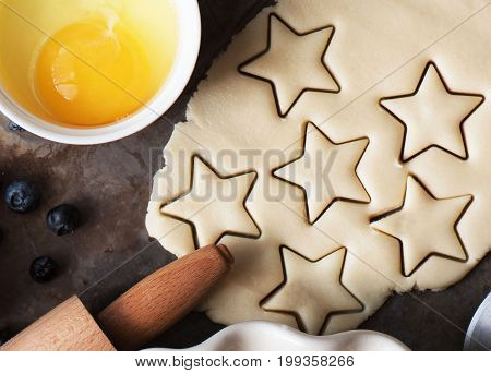 Cookies stars cut out of the dough preparation before baking. Top view