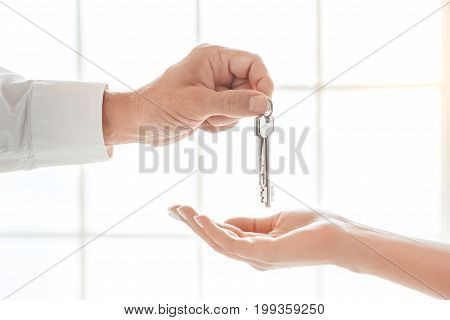 Woman with real estate agent rent apartment giving keys