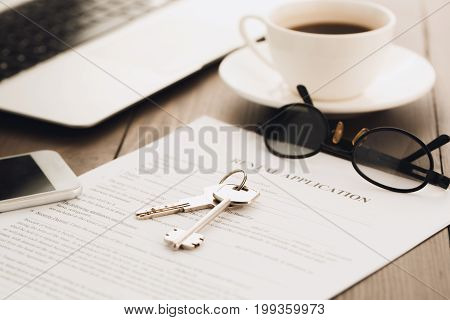 Real estate agency office objects on wooden table no people