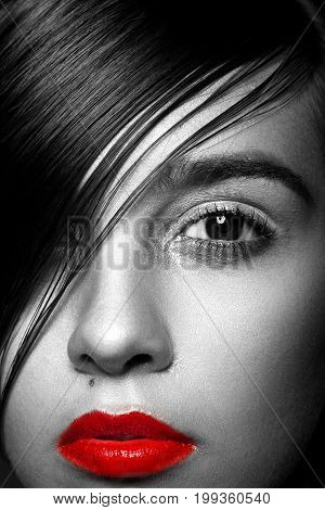 Fashion Haircut. Hairstyle. Stylish Fringe. Short Hair Style. Beauty woman portrait with fashion trendy hair style.Closeup shot.Black and white red lips