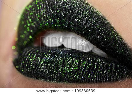 Close-up Of Beautiful Womanish Lips Black With Green.cosmetology, Drugstore Or Fashion Makeup Concep