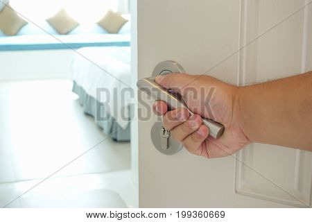 Picture showing hand of man opening hotel room, Selective focus