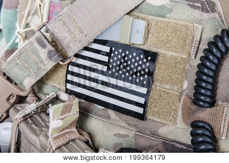 American flag stars stripes military patch on camouflage uniforms