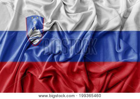 Ruffled waving Slovenia flag national flag close