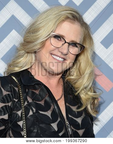 LOS ANGELES - AUG 08:  Nancy Cartwright arrives for the FOX TCA Summer Press Tour 2017 on August 8, 2017 in West Hollywood, CA