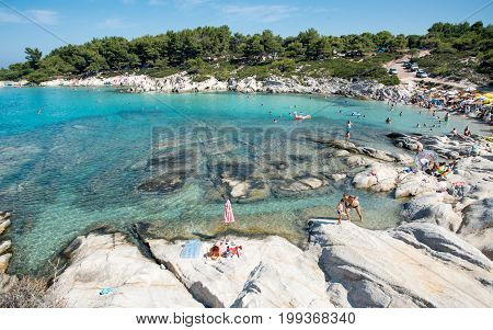 Chalkidiki Greece- July 26 2017: Famous and idyllic beach of Kavourotripes with people swimming resting and enjoying their summer vacations at Sithonia Peninsula in Chalkidiki Greece