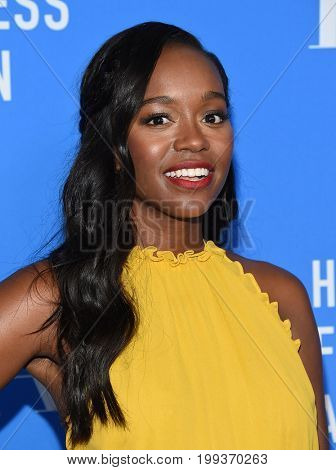 LOS ANGELES - AUG 02:  Aja Naomi King arrives for the HFPA's Grants Banquet on August 2, 2017 in Beverly Hills, CA