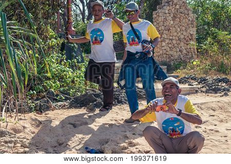 Bali, Indonesia - August 5, 2017: Group Of Indonesian Tourists On The Beach Of Tropical Island Of Ba