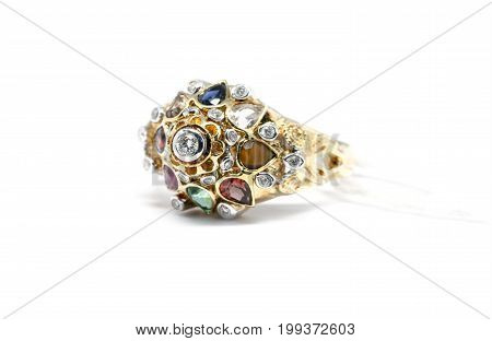Emerald, Blue Sapphire And Pink Diamond With White Diamond And Gold Ring Isolated