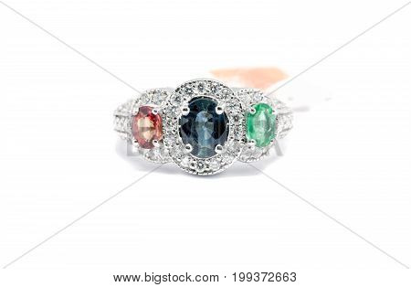Closed Up Emerald, Blue Sapphire And Pink Diamond With White Diamond And Platinum Ring