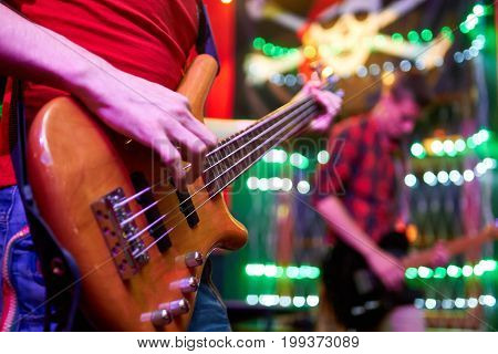 Close up photo of guitar in man's hands