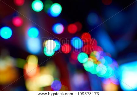 Abstract celebratory background of defocused lights with reflection