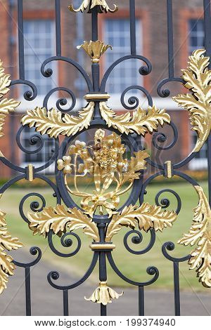 LONDON UNITED KINGDOM - JUNE 23 2017: Kensington Palace set in Kensington Gardens decorative gate. It has been a residence of the British Royal Family since the 17th century and Queen Victoria's birthplace