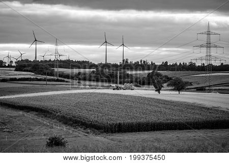 Agricultural machinery on the fields in the suburbs of the small town of Neustadt (Marburg-Biedenkopf district in Hessen). Black and white.