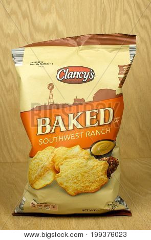 RIVER FALLS,WISCONSIN-AUGUST 12,2017: A bag of Clancy's brand southwest ranch flavored potato crisps with a wood background.