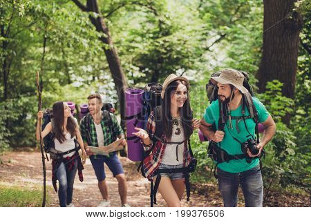 Two Cheerful Couples Are Clmbing Up The Hill, Talking, Having Fun Together, Wearing Comfortable Outf