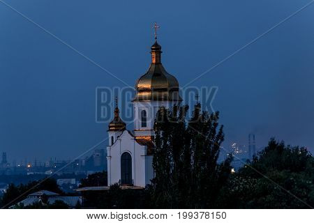 The Church against the backdrop of city lights in the dusk