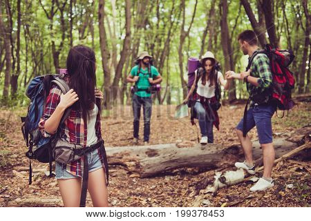 Trust, Love, Support, Help, Friendship Concept. Four Friends Are Hiking In The Spring Woods, The Guy