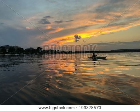 Kayaking At Sunset In Fredericton On The Saint John River , New Brunswick, Canada