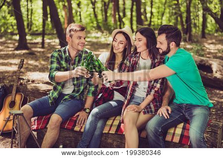 Cheers! To Us! Four Cheerful Tourists Friends Are Chilling, Having Beer, Nice Sunny Summer Day, Sitt