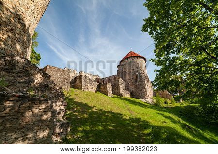 Ruins of the ancient castle in old town of Cesis. Ultra wide angle view.