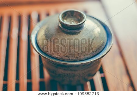 Chinese tea cup or Gaiwan, close up, selective focus, toned