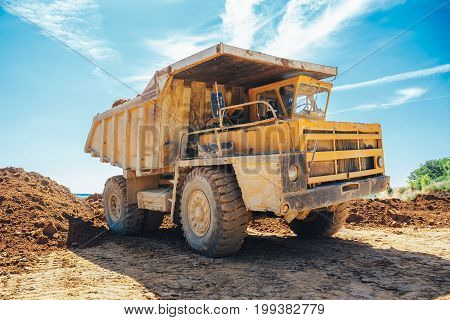 Big yellow mining truck, work in mining qyarry