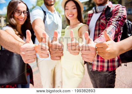 Close Up Of Six Like Signs Of Different Multi Cultural Students, Gesturing, Smiling, Standing Near E