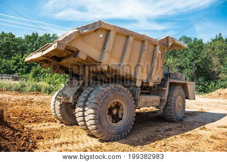 Large industrial truck,  quarry for mining mineral