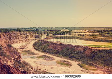 Quarry landscape, opencast mining of copper, silver, gold, minerals. Toned image