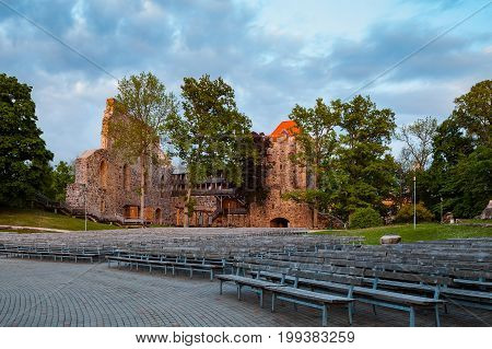 View of old medieval castle ruins at sunset in Sigulda. Latvia