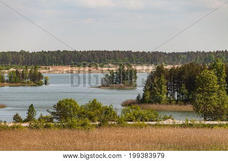 Abandoned sand quarry with lakes and forest
