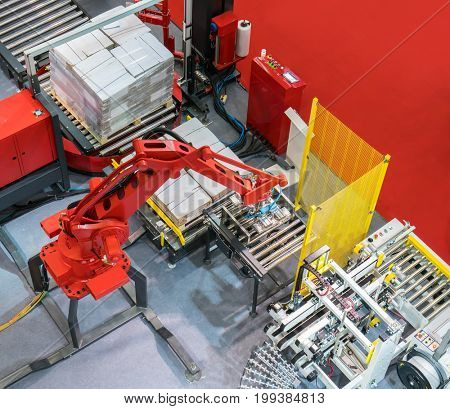 Robotic arm at production line with automatic conveyor belt, industry track.