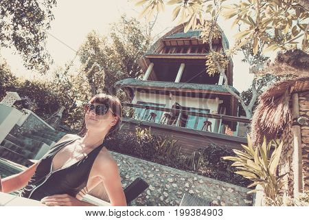 Close Up Of Beautiful Sexy Young Woman On A Bungalow Background. Tropical Island Of Nusa Lembongan,