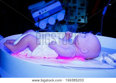 Mannequin infant in an incubator. Medical equipment