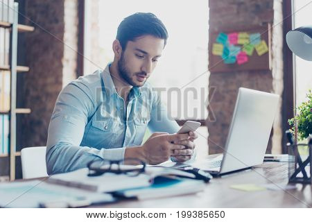 Close Up Of Confident Handsome Young Middle Eastern Lawyer Guy Is Browsing Information On His Samrt