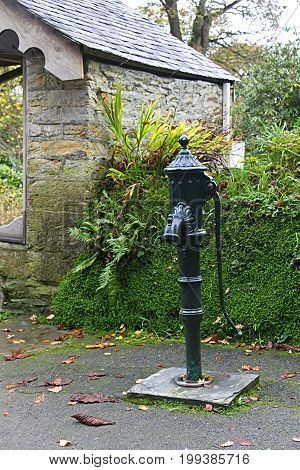 Old Village green water pump not longer in use