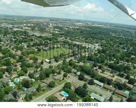 Aerial view of residential area from a plane. Summer time Ontario Canada