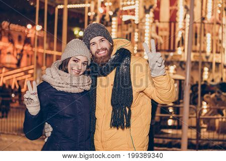 Christmas Time Together! Young Happy Couple Is Having A Walk In A Park Of Attractions On A Christmas