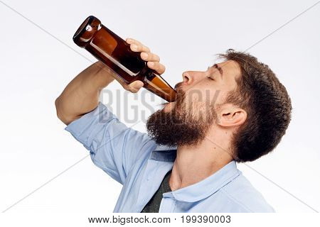 Man with a beard on a white isolated background drinking beer, portrait, alcohol.