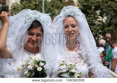 Two Brides Participating In Prague Pride - A Big Gay & Lesbian Pride