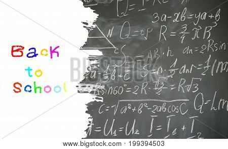 school background with math formulas written in white chalk on black board border with copy space