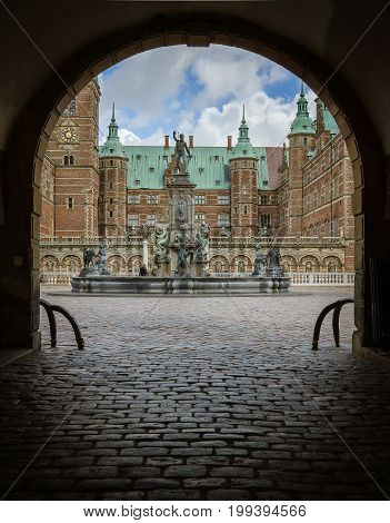 Archway and entrance through the dark gate to Frederiksborg castle. Hillerod Denmark August 6 2017