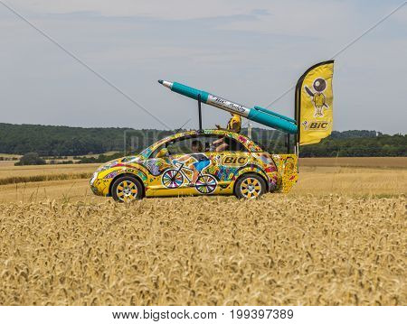 Vendeuvre-sur-Barse France - 6 July 2017: The fancy car of BIC passes through a region of wheat fields in the Publicity Caravan before the cyclists during the stage 6 of Tour de France 2017.