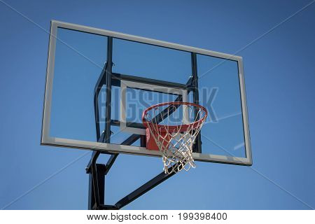 New basketball hoop at a park with blue skies