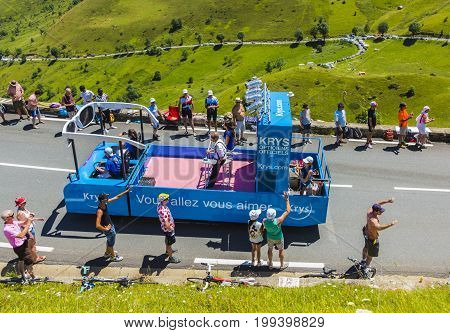 Col de PeyresourdeFrance- July 23 2014: Krys vehicle during the passing of the Publicity Caravan on the road to Col de Peyresourde in Pyrenees Mountains in the stage 17 of Le Tour de France on 23 July 2014.Krys is a major chain of optical stores in France