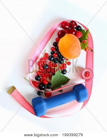 Menu diet plan or program, tape measure, dumbbells and diet food fresh fruits on a white background. Weight loss and the concept of detoxification.